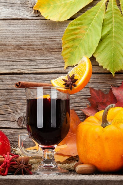 Autumn still life with mulled wine and pumpkins