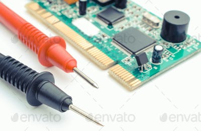 Cable of multimeter with circuit board on white background