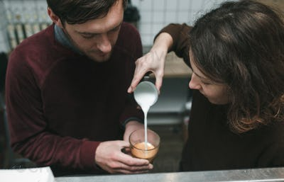 Vintage couple preparing coffee with vacuum coffee maker.Coffee