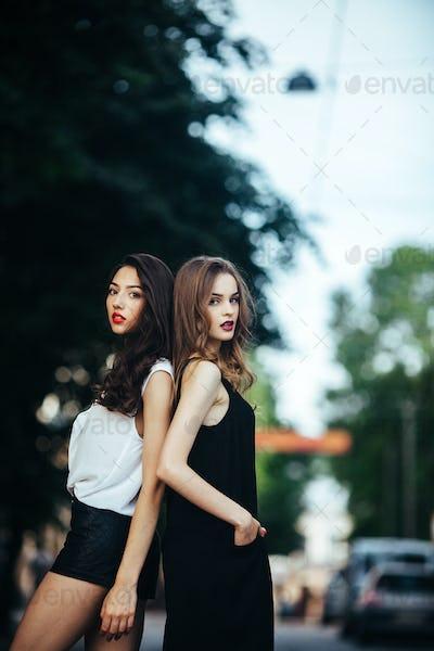 pretty girls posing in a city street