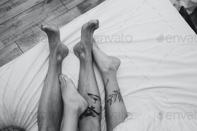 Young adult couple lying on bed