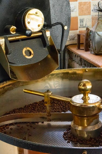 Raw Organic Fresh Coffee Beans Roasting In Machine