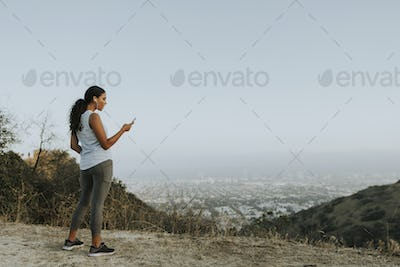 Cheerful woman using a mobile phone