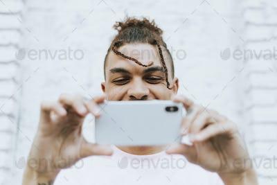 Man taking a selfie in downtown