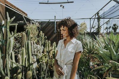 Beautiful woman at a cactus garden