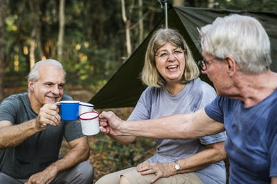 Friends having coffee at a campsite