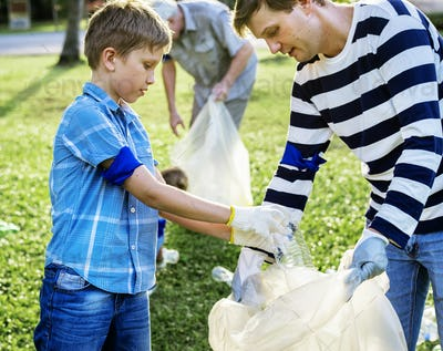 Kids picking up trash in the park