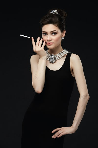 beautiful young woman in retro style with cigarette