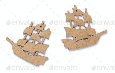 wooden ship toy at white background