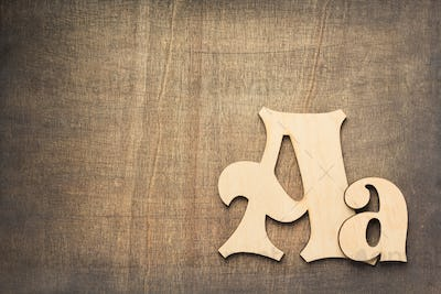 wooden letters at old background