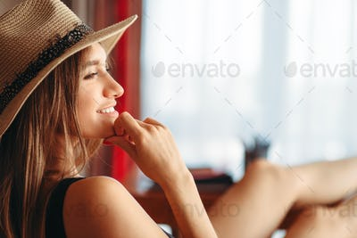 Woman threw legs on table, dream about vacation