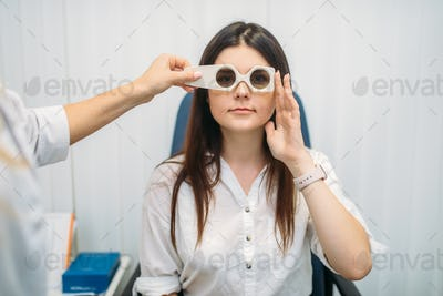 Patient on diagnostic of vision, optician cabinet