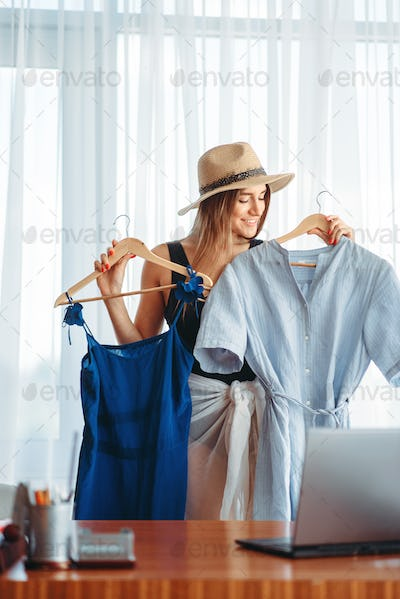 Woman chooses dresses, dreams about a vacation