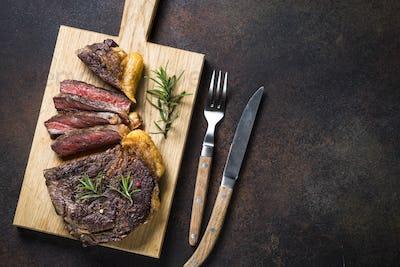 Grilled beef steak ribeye on wooden cutting board