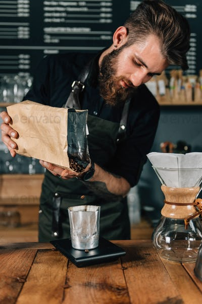 Barista Weighs Coffee On Scales