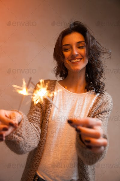 Close-up of sparkler in woman hands