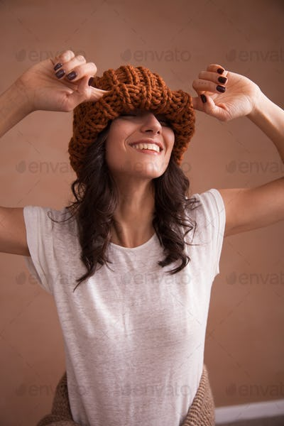 Happy smiling woman in knitted hat