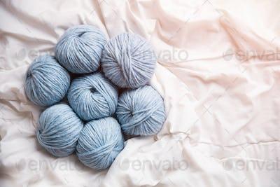 Yarn clews on white fabric closeup
