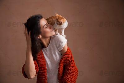 Little kitten on woman shoulder