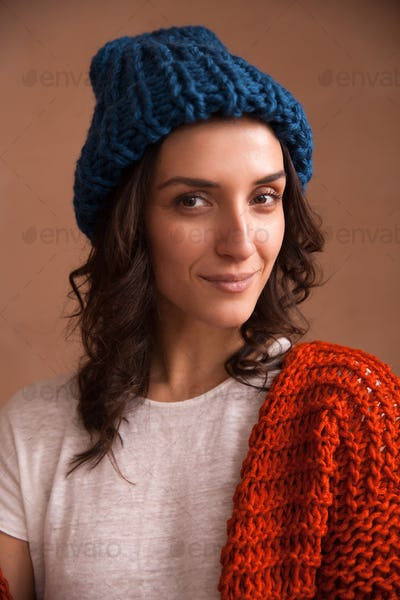Portrait of young woman wearing knitted clothes