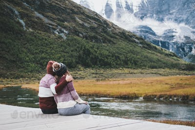 Hiking young couple traveler sitting and looking beautiful landscape, Travel lifestyle concept