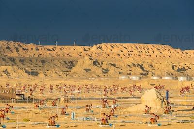 xinjiang windy city oil field at dusk