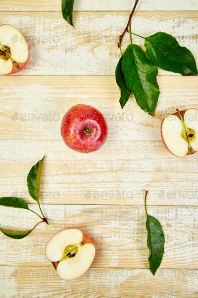 Fresh red ripe apples fruits whole and sliced