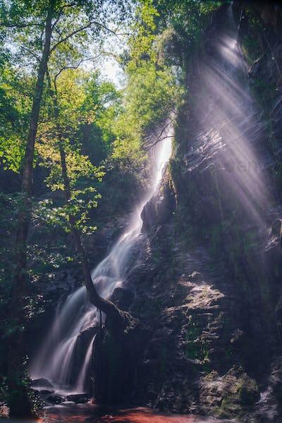 Sunbeams over a Waterfall
