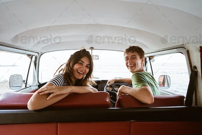 young couple happiness enjoy a trip and looking back at camera