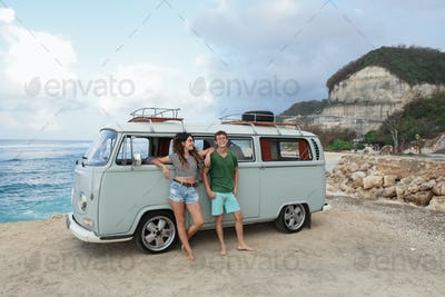 young couple cheerful and smiling while leaning at their retro s