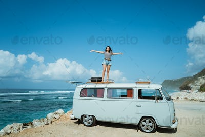 beauty woman raise hands enjoy blow wind on the roof