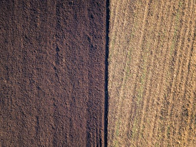 Aerial photo of a ploughed field in a countryside