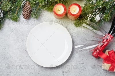 Christmas table setting with champagne and xmas gift