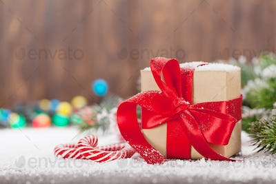 Christmas gift box, candy canes and tree