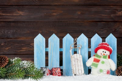 Christmas snowman and sledge toys and fir tree