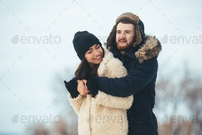 man and woman posing for the camera