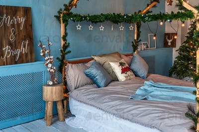 Room, decorated for christmas with: bed, tree with presents and toys and lights