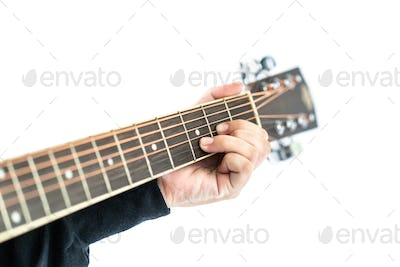 Hands playing guitar on white
