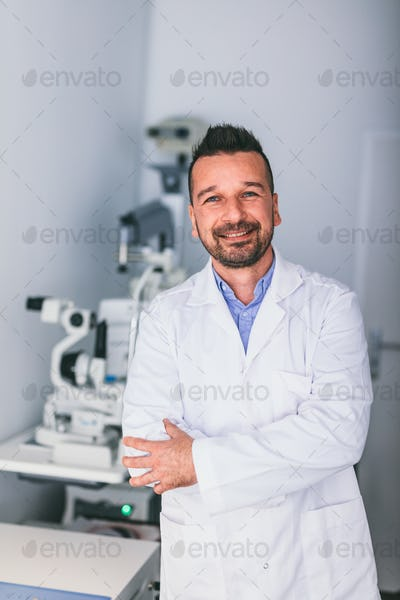 Doctor in his office, exam room.