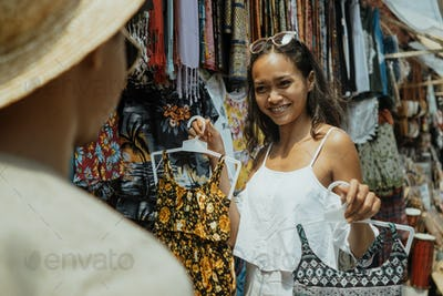 woman buying some clothes in souvenir shop