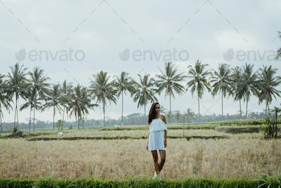 woman taking picture for social media in rice field