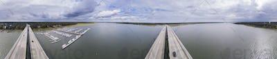 Aerial 360 degree view panorama of coastal highway bridge and ma