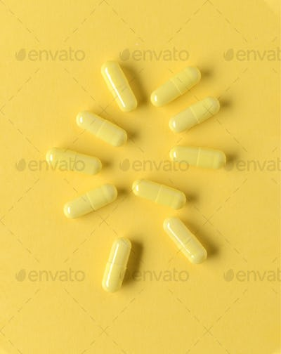 aerial view of group of yellow dragees in color background