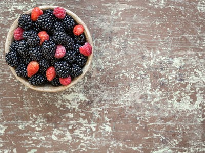Small clay bowl of freshly assorted berries
