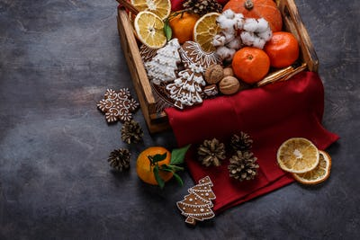 Christmas decoration with gingerbread cookies, dry oranges, nuts and tangerines, copyspace