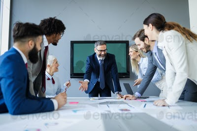 Business people conference in modern meeting room