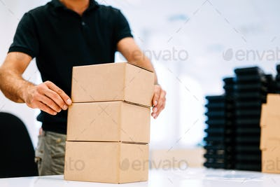 Picture of man boxing products for dispatching