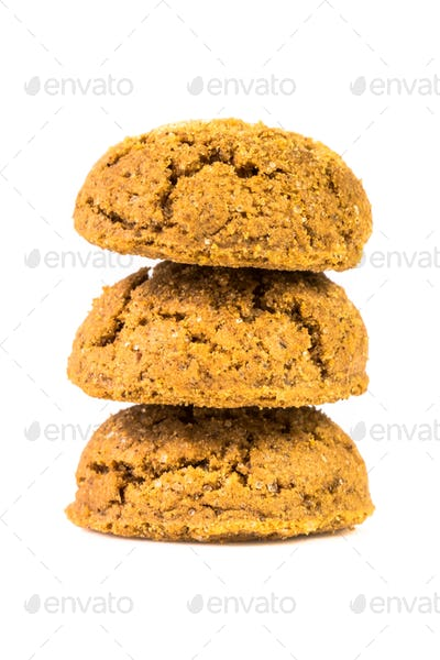 Pile of three pepernoten treats on white background
