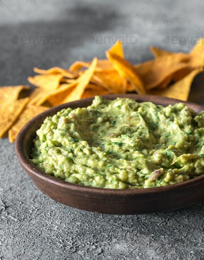 Guacamole in bowl with tortilla chips