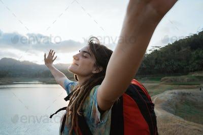 caucasian woman hiker alone enjoy the beauty of nature